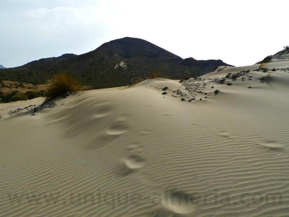 Climbing sand dunes on my way from Monsul to Barronal beach